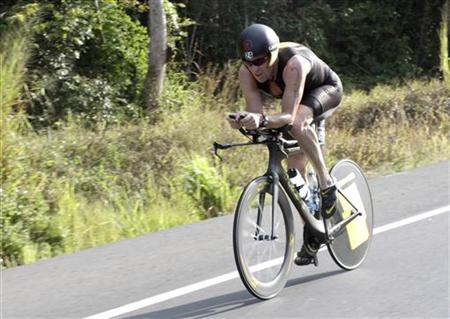 Lance Armstrong of the U.S. cycles during the Ironman Panama 70.3 triathlon in Panama City February 12, 2012. REUTERS/Alberto Muschette/Files