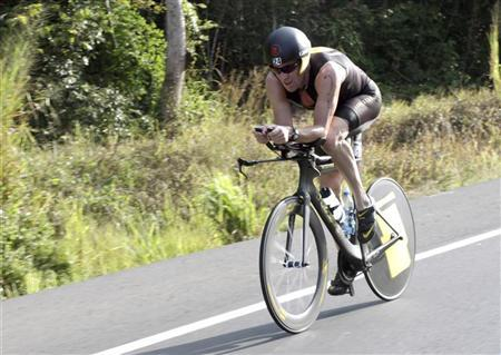 Lance Armstrong of the U.S. cycles during the Ironman Panama 70.3 triathlon in Panama City February 12, 2012. REUTERS/Alberto Muschette