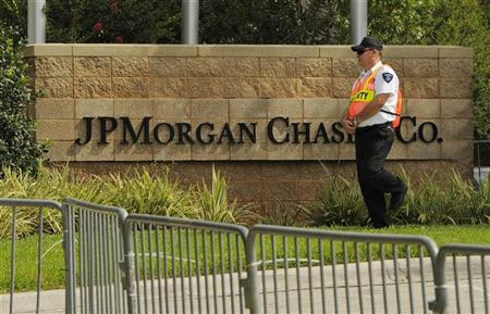 A security guard patrols outside the JP Morgan Chase & Co annual shareholders meeting at the bank's back-office complex in Tampa, Florida, May 15, 2012. REUTERS/Brian Blanco