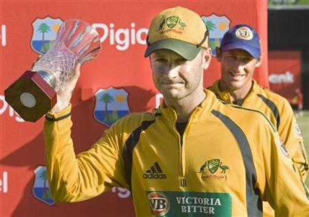 Australia's captain Michael Clarke holds up the one-day cricket international series trophy after they defeated West Indies in the final match in Basseterre, St. Kitts July 6, 2008. REUTERS/Andy Clark