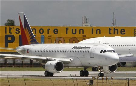 A Philippine Airlines (PAL) plane, the country's flag carrier, waits at the tarmac of the international airport in Manila April 10, 2012. REUTERS/Romeo Ranoco
