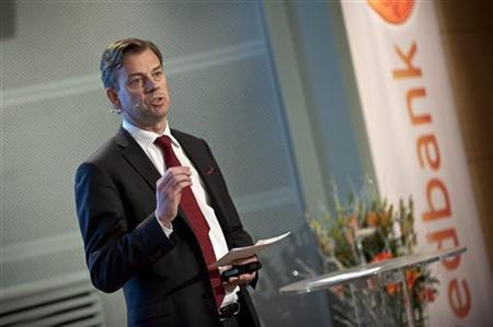 Swedbank Chief Executive Officer Michael Wolf presents the company's fourth-quarter results during a news conference in Stockholm February 8, 2011. REUTERS/Scanpix