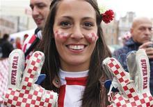 Болельщица сборной Хорватии в Познани, 14 июня 2012 года. Croatia and Italy will play their Euro 2012 Group C soccer match at the Municipal Stadium in Poznan on Thursday. Матч группы C между сборными Италии и Хорватии состоится в четверг в Познани в рамках чемпионата Европы. REUTERS/Tony Gentile
