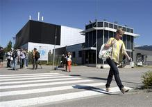 Jekaterina Kapanen (R) leaves the Nokia mobile phone plant, after Nokia's CEO Stephen Elop's statement that was relayed by video link to employees in Nokia locations around Finland, in Salo, south-western Finland, June 14, 2012. Loss-making Finnish cellphone maker Nokia plans to cut another 10,000 jobs globally in its biggest revamp in recent history, while it warned the second-quarter loss from its cellphone business would be larger than expected. The cuts, which include the closure of Nokia's only plant in Finland, bring total planned job cuts at the group since Elop took over as chief executive in 2010 to more than 40,000. REUTERS/Antti Aimo-Koivisto/Lehtikuva