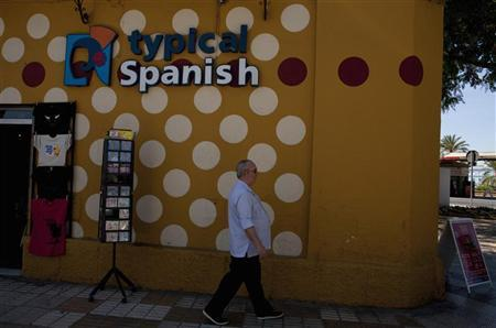 A man walks past a souvenir shop in the Andalusian capital of Seville, southern Spain June 10, 2012. REUTERS/Marcelo del Pozo