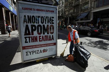 A municipal worker cleans the street next to a pre-election poster of Greece's radical left SYRIZA party in Athens June 14, 2012. Greece holds general parliamentary elections on June 17. The poster reads ''We open the road to hope''. REUTERS/Pascal Rossignol (GREECE - Tags: POLITICS ELECTIONS)