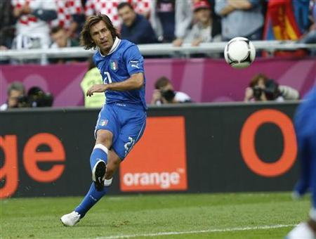 Italy's Andrea Pirlo shoots to score a goal against Croatia during their Group C Euro 2012 soccer match at the city stadium in Poznan June 14, 2012. REUTERS/Dominic Ebenbichler