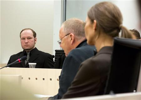Mass murderer Anders Behring Breivik looks toward psychiatrists Torgeir Husby and Synne Soerheim (L-R) during his trial at a courthouse in Oslo June 14, 2012. REUTERS/Heiko Junge/NTB Scanpix/Pool