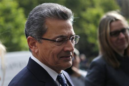 Former Goldman Sachs Group Inc board member Rajat Gupta (L) arrives at Manhattan Federal Court in New York June 14, 2012. REUTERS/Mike Segar
