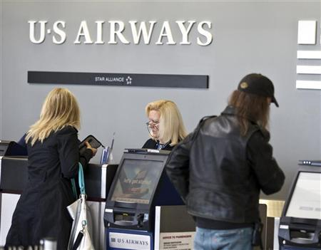 US Airways passengers check in for their flights at Charlotte Douglas International Airport in Charlotte, North Carolina April 20, 2012. REUTERS/Chris Keane