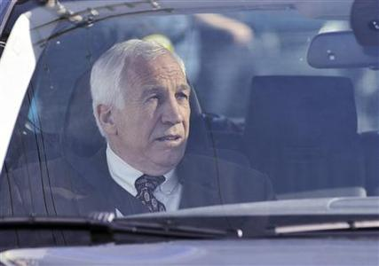 Former Penn State assistant football coach Jerry Sandusky arrives at the Centre County Courthouse for the fourth day of his child sex abuse trial in Bellefonte, Pennsylvania June 14, 2012. REUTERS/Pat Little