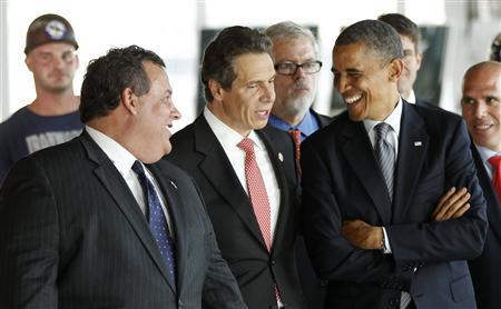 U.S. President Barack Obama talks with New York Governor Andrew Cuomo (C) and New Jersey Governor Chris Christie as he tours the One World Trade Center building which is under construction, in New York June 14, 2012. REUTERS/Kevin Lamarque