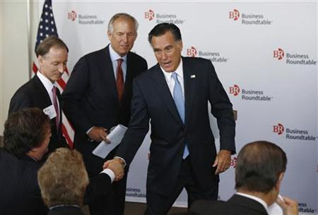 U.S. Republican Presidential candidate Mitt Romney greets CEOs after addressing a business roundtable with company leaders in Washington, June 13, 2012. Pictured alongside Romney is Boeing CEO James McNerney. REUTERS/Jason Reed