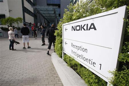 Nokia employees arrive for a personnel briefing in Oulu, June 14, 2012. Loss-making Finnish cellphone maker Nokia plans to cut another 10,000 jobs globally in its biggest revamp in recent history, while it warned the second-quarter loss from its cellphone business would be larger than expected. The cuts, which include the closure of Nokia's only plant in Finland, bring total planned job cuts at the group since Elop took over as chief executive in 2010 to more than 40,000. REUTERS/Markku Ruottinen/Lehtikuva