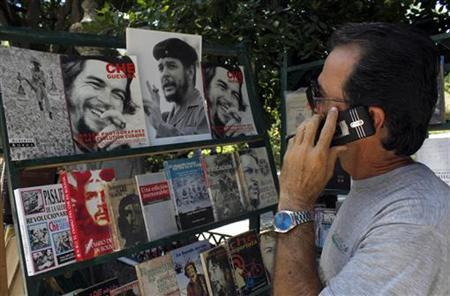 A man speaks on his cell phone on a street in Havana June 13, 2012. REUTERS/STRINGER