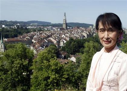 Myanmar's opposition leader Aung San Suu Kyi poses for a picture in the Rosengarden in Bern June 15, 2012. Suu Kyi, recovering from a brief illness, attended a session of the Swiss parliament on Friday hours before she was due to fly to Oslo to finally collect her 1991 Nobel Peace Prize. REUTERS/Ruben Sprich