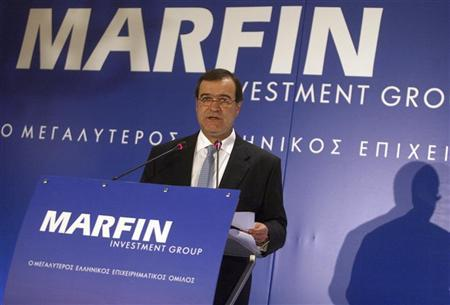 Then-Chairman of Marfin Investment Group Andreas Vgenopoulos addresses journalists during news a conference in Athens, June 22, 2009. REUTERS/Icon