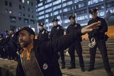 Activist Austin Guest guides other protesters in front of a police line in New York May 1, 2012. REUTERS/Andrew Burton