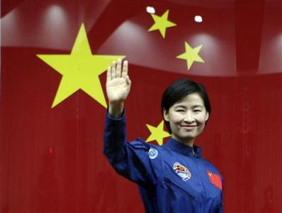 China's first female astronaut Liu Yang waves to the media as she leaves a news conference at Jiuquan Satellite Launch Center, in northwest China's Gansu province, June 15, 2012. REUTERS/Jason Lee