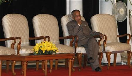 India's Finance Minister Pranab Mukherjee waits for a function, held on the completion of the government's three years in office, to begin in New Delhi May 22, 2012. REUTERS/B Mathur/Files