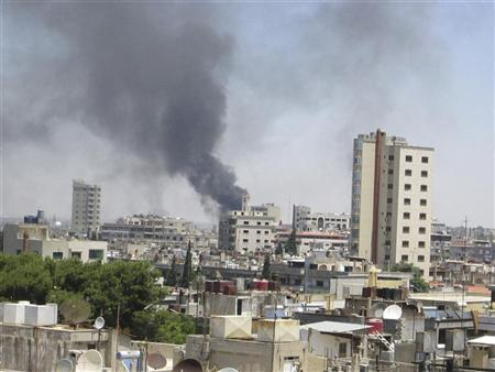 Smoke rises from a residential area of Talbisah in Homs city June 9, 2012. REUTERS/Handout/David Manyua/United Nations