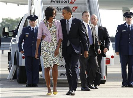 U.S. President Barack Obama and first lady Michelle Obama arrive in New York June 14, 2012. REUTERS/Kevin Lamarque