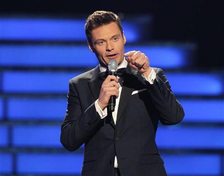 Host Ryan Seacrest presides over the 11th season finale of ''American Idol'' in Los Angeles, California, May 23, 2012. REUTERS/Mario Anzuoni