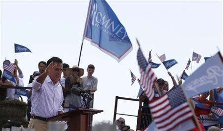 U.S. Republican Presidential candidate Mitt Romney waves to supporters at a campaign event at the Scamman Farm in Stratham, New Hampshire, June 15, 2012. Romney is kicking off a five-day tour through the battleground states. REUTERS/Larry Downing