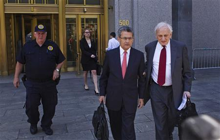 Former Goldman Sachs Group Inc board member Rajat Gupta (2nd R) leaves Manhattan Federal Court with his lawyer, Gary Naftalis (R), following a guilty verdict in New York June 15, 2012. Gupta was convicted on Friday of illegally tipping his hedge-fund manager friend Raj Rajaratnam with secrets about the investment bank, a major victory for prosecutors seeking to root out insider trading on Wall Street. REUTERS/Lucas Jackson