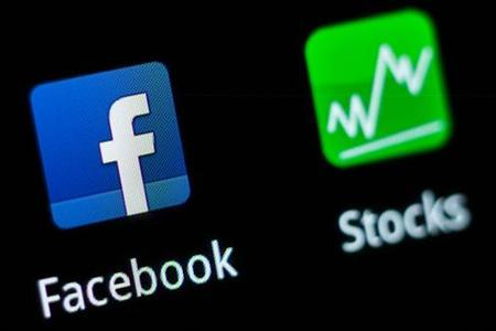 A Facebook application logo is pictured on a mobile phone in this photo illustration taken in Lavigny May 16, 2012. REUTERS/Valentin Flauraud