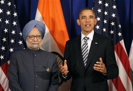 U.S. President Barack Obama speaks alongside Indian Prime Minister Manmohan Singh on the sidelines of the ASEAN Summit in Nusa Dua, Bali, November 18, 2011. REUTERS/Jason Reed/Files