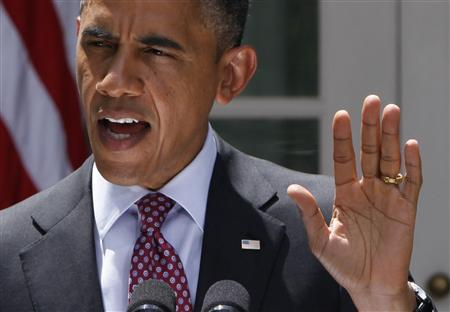 U.S. President Barack Obama responds to a reporter's questions as he speaks about immigration from the Rose Garden of the White House in Washington June 15, 2012. REUTERS/Yuri Gripas