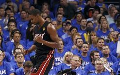 Miami Heat forward Chris Bosh reacts in the first half during Game 2 of the NBA basketball finals against the Oklahoma City Thunder in Oklahoma City, Oklahoma, June 14, 2012. REUTERS/Jim Young