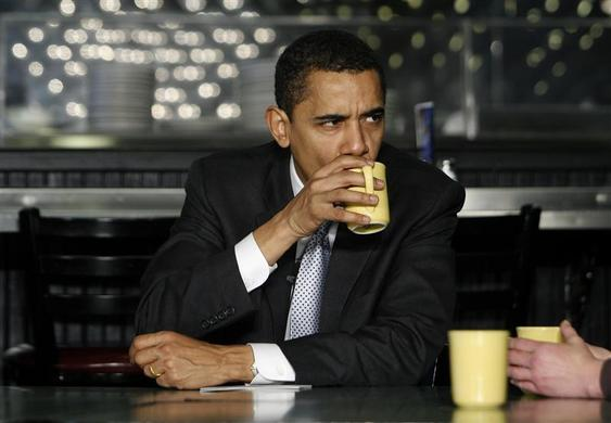 Then Democratic presidential candidate Senator Barack Obama sips his drink as speaks to a group of woman during a round table discussion in Charleston, South Carolina, January 25, 2008. REUTERS-Joshua Lott