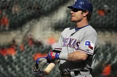 Texas Rangers batter Josh Hamilton stands on deck before batting against the Baltimore Orioles in their first game of a doubleheader during their MLB American League baseball game in Baltimore, Maryland, May 10, 2012. REUTERS/Patrick Smith