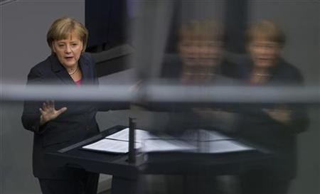 German Chancellor Angela Merkel delivers a government statement on her policy plans for the upcoming Mexico G20 summit at the Bundestag, the German lower house of parliament, in Berlin June 14, 2012. REUTERS/Thomas Peter