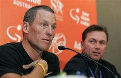 Seven-time Tour de France winner Lance Armstrong (L) talks to the media as Astana team general manager Johan Bruyneel looks on during news conference before the Tour Down Under in Adelaide January 17, 2009. REUTERS/Brandon Malone