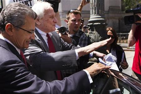 Former Goldman Sachs Group Inc board member Rajat Gupta (L) leaves Manhattan Federal Court with his lawyer, Gary Naftalis, following a guilty verdict in New York June 15, 2012. REUTERS/Lucas Jackson