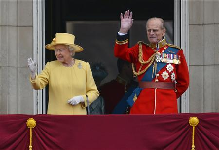 Britain's Queen Elizabeth (L) and her husband Prince Philip stand on the balcony of Buckingham Palace following the Trooping the Colour ceremony in central London June 16, 2012. Trooping the Colour is a ceremony to honour the sovereign's official birthday. REUTERS/Toby Melville