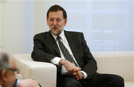 Spanish Prime Minister Mariano Rajoy listens to European Union Competition Commissioner Joaquin Almunia (not pictured) during their meeting at Moncloa palace in Madrid June 15, 2012. REUTERS/Andrea Comas