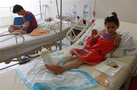 Yasmin abou Omar, a 5-year-old Syrian girl, eats in her bed at a government hospital in Tripoli, north Lebanon, June 15, 2012. REUTERS/Omar Ibrahim