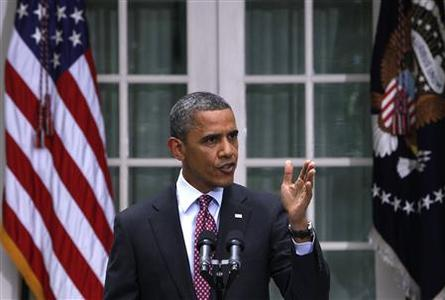 U.S. President Barack Obama responds to a reporter's question as he speaks about immigration from the Rose Garden of the White House in Washington June 15, 2012. REUTERS/Yuri Gripas