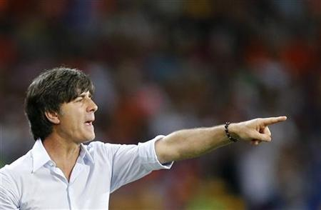 Germany coach Joachim Loew reacts during their Group B Euro 2012 soccer match against Netherlands at the Metalist stadium in Kharkiv, June 13, 2012. REUTERS/Thomas Bohlen