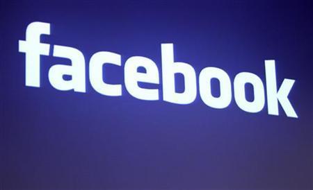 Логотип Facebook показана на Facebook штаб-квартирой в Пало-Альто, Калифорния, 26 мая 2010. REUTERS / Robert Galbraith