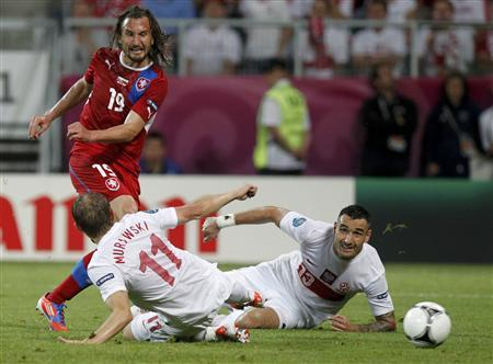 Czech Republic's Petr Jiracek (red) scores a goal past Poland's Rafal Murawski (L) and Poland's Marcin Wasilewski (R) during their Group A Euro 2012 soccer match at the City Stadium in Wroclaw, June 16, 2012. REUTERS/Kacper Pempel