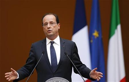 French President Francois Hollande gestures during a news conference with Italian Prime Minister Mario Monti at Chigi palace in Rome June 14, 2012 . REUTERS/Max Rossi