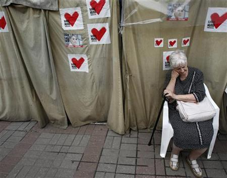 A supporter of former Ukrainian Prime Minister Yulia Tymoshenko sits in a protest tent camp in central Kiev June 15, 2012. REUTERS/Gleb Garanich