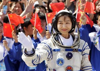 Liu Yang, China's first female astronaut, waves during a departure ceremony at Jiuquan Satellite Launch Center, Gansu province, June 16, 2012. China will send its first woman into outer space this week, prompting a surge of national pride as the rising power takes its latest step towards putting a space station in orbit within the decade. Liu, a 33-year-old fighter pilot, will join two other astronauts aboard the Shenzhou 9 spacecraft when it lifts off from a remote Gobi Desert launch site on Saturday evening. REUTERS/Jason Lee