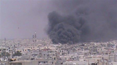 Smoke rises from Homs June 13, 2012. Escalating violence in Syria forced United Nations observers to suspend operations on Saturday, in the clearest sign yet that a peace plan brokered by international mediator Kofi Annan has collapsed. Picture taken June 13, 2012. REUTERS/Shaam News Network/Handout