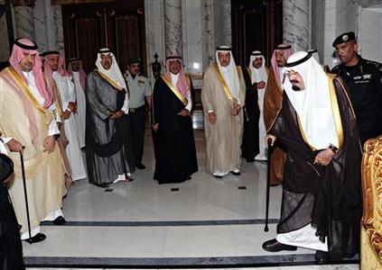 Saudi Arabia's King Abdullah (R) arrives in Mecca to attend the funeral of Saudi Crown Prince Nayef June 17, 2012. REUTERS/Saudi Press Agency/Handout